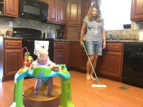 a baby activity center makes it easier to get things done around the house