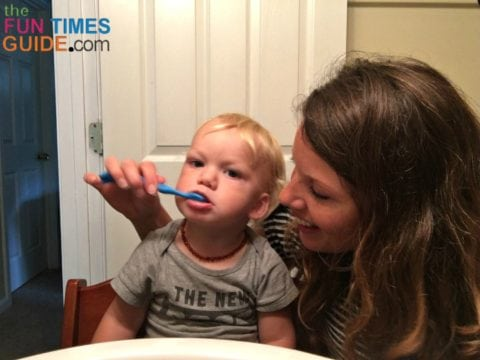 I start by brushing my baby's teeth myself...