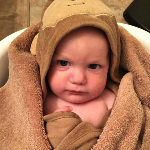 My baby wrapped in a hooded towel after a bath