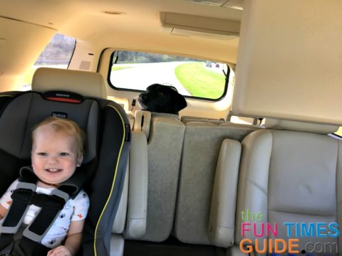 All smiles! Traveling with a toddler in the car is fun... as long as mom remembers to pack all the 'necessities'!