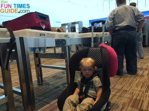 I rolled my toddler through the airport in his car seat using a car seat dolly that I made using a basic luggage cart.