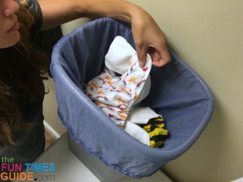 Dirty cloth diapers in the diaper pail - the pockets and the inserts are separated before placing them in the diaper pail.
