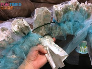 How to attach disposable diapers to a wire wreath frame.