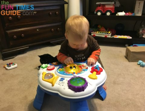 My son fully engaged with the Baby Einstein music table.