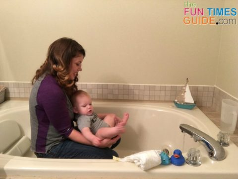 This is how I'm teaching my baby to go potty without a diaper -- in the bathtub or shower.