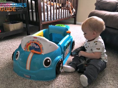 My one year old pretending to 'fix' the Fisher Price Crawl Around Car.
