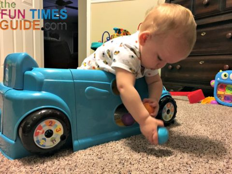 Playing with the colorful balls and the ball ramp on the Fisher Price Crawl Around Car door.