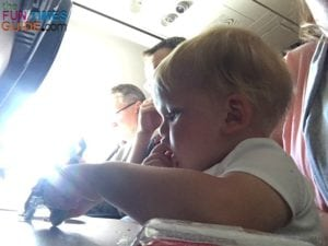 My 14-month-old was very well behaved on his first flight. I'm glad we had an aisle seat - because it was a full flight!