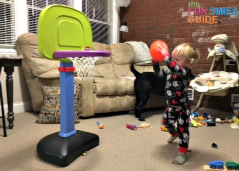 My son enjoying his new Little Tikes basketball hoop.