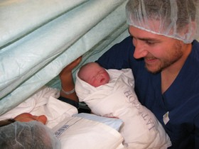 parents-holding-newborn-baby-by-beccaplusmolly.jpg