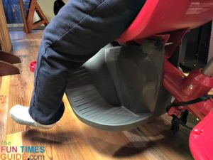 He's also too big to use the footrest on this toddler trike.
