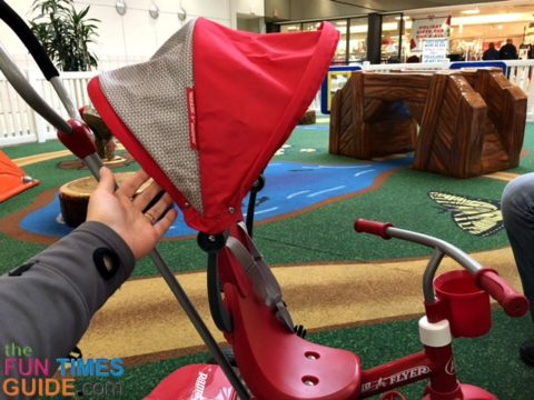 The Radio Flyer tricycle has a detachable stroller-style canopy.