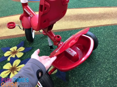 There's a small covered bin for storage on the Radio Flyer 4-in-1 trike.