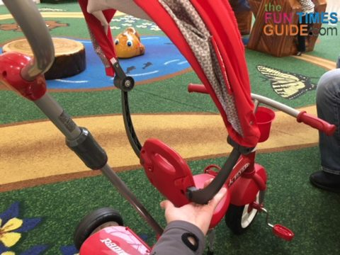 The Radio Flyer's canopy detaches in seconds by pushing the release buttons.