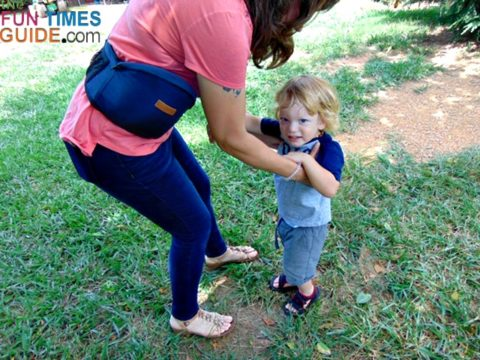It's easy to move around with this toddler hip seat carrier attached to your waist... and easy to pick up and put down your child too.
