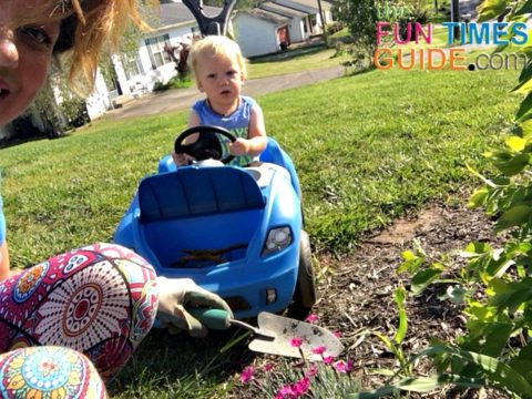 This toddler ride on push car stroller is perfect for when I'm doing yardwork outside!