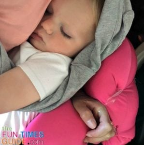 A travel pillow comes in handy in various ways when you're flying with a toddler.