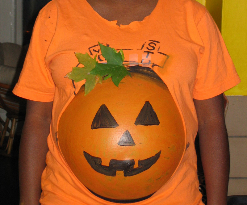 pregnant belly decorated like a pumpkin by jilyfish16 ss Basketball 225x300 10 Awesome Halloween Costume Ideas For Pregnant Chicks